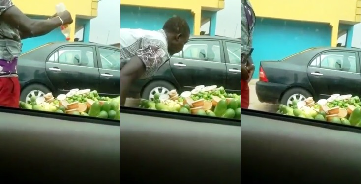 Local fruit vendor spotted making incantations and spitting on fruits for sale (Video)