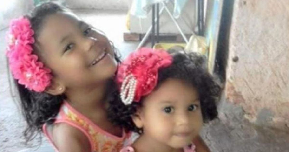 Two sisters, 5 and 6, found in each other's arms after being killed in house fire
