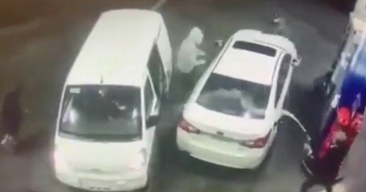 Driver fends off thieves by dousing them with petrol in terrifying car raid