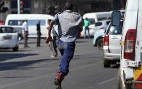 Cops Flee As Illegal Kombi Operators Attack Them