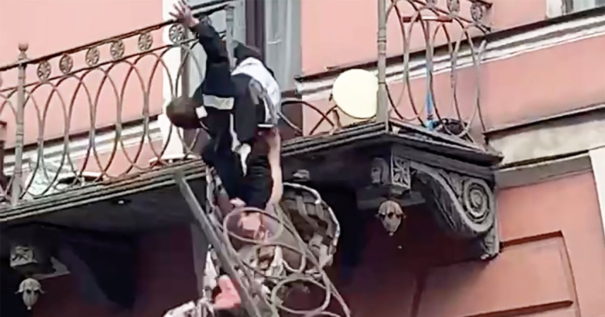 Terrifying moment couple plunge from 25ft balcony during heated argument