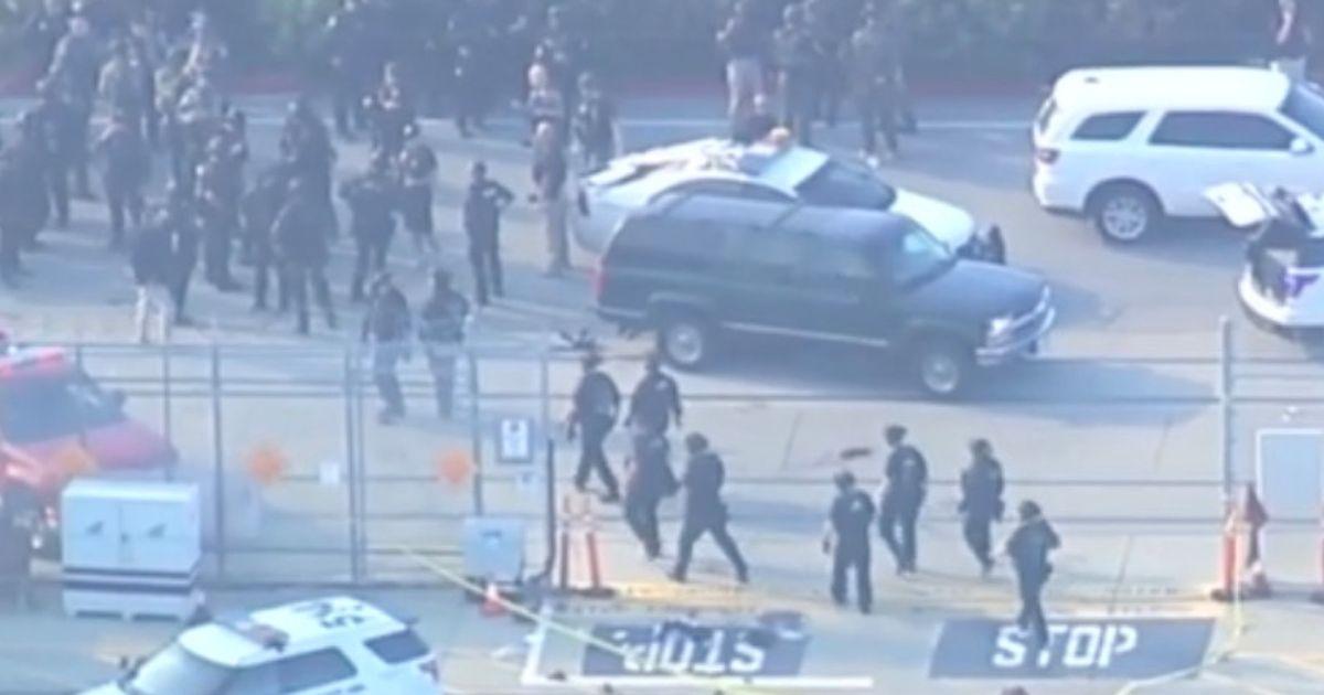 Gunman leaves seven people dead in shooting near prison as police surround scene