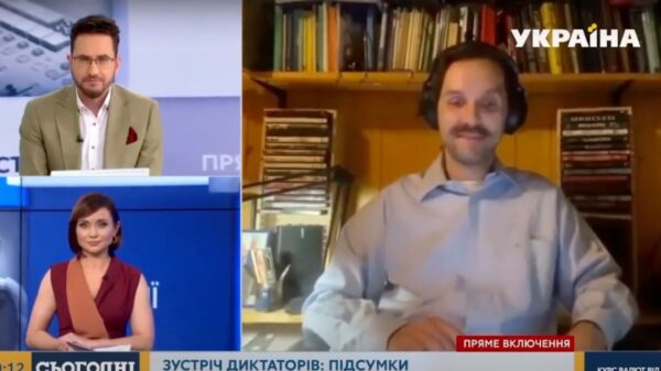 TV hosts left red-faced after naked woman crashes live report on Vladimir Putin