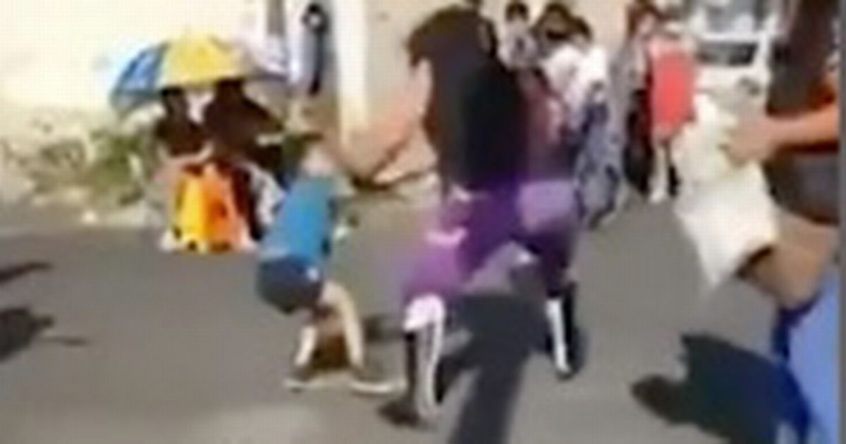 Horrifying moment pro wrestler launches boy, 5, across street after losing fight