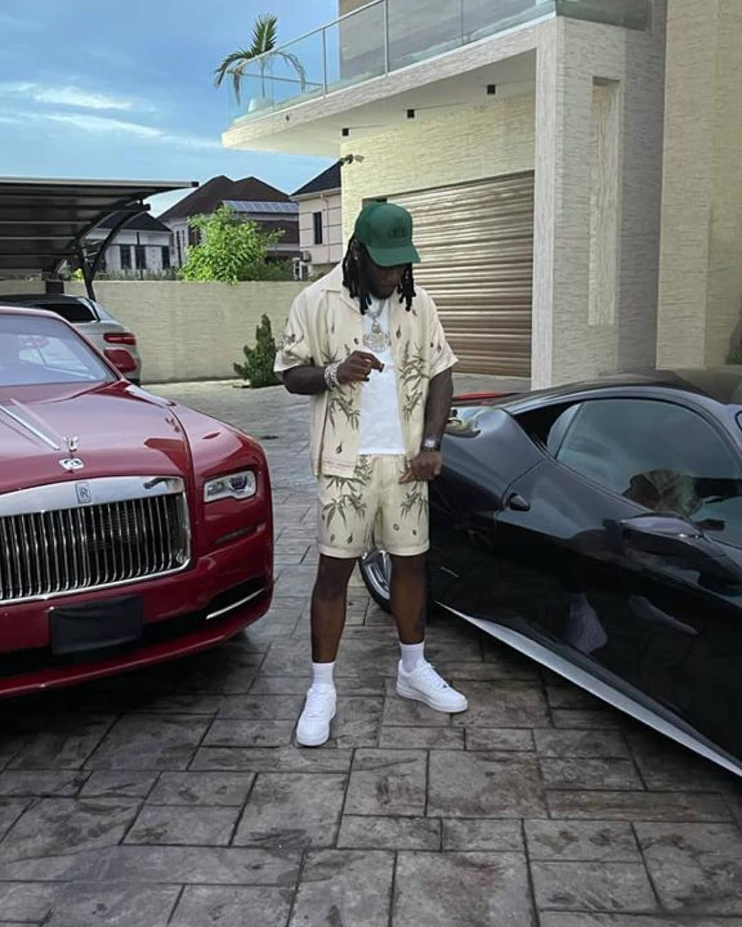 Burna Boy Shows Off His Expensive Cars (Video)