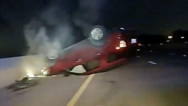 Terrifying moment police flip over pregnant woman's car after she 'refused to stop'