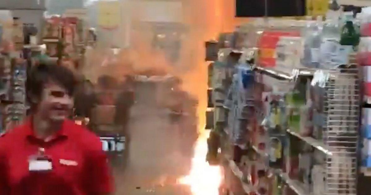 Worker calmly walks away after watching teens set off fireworks in shop