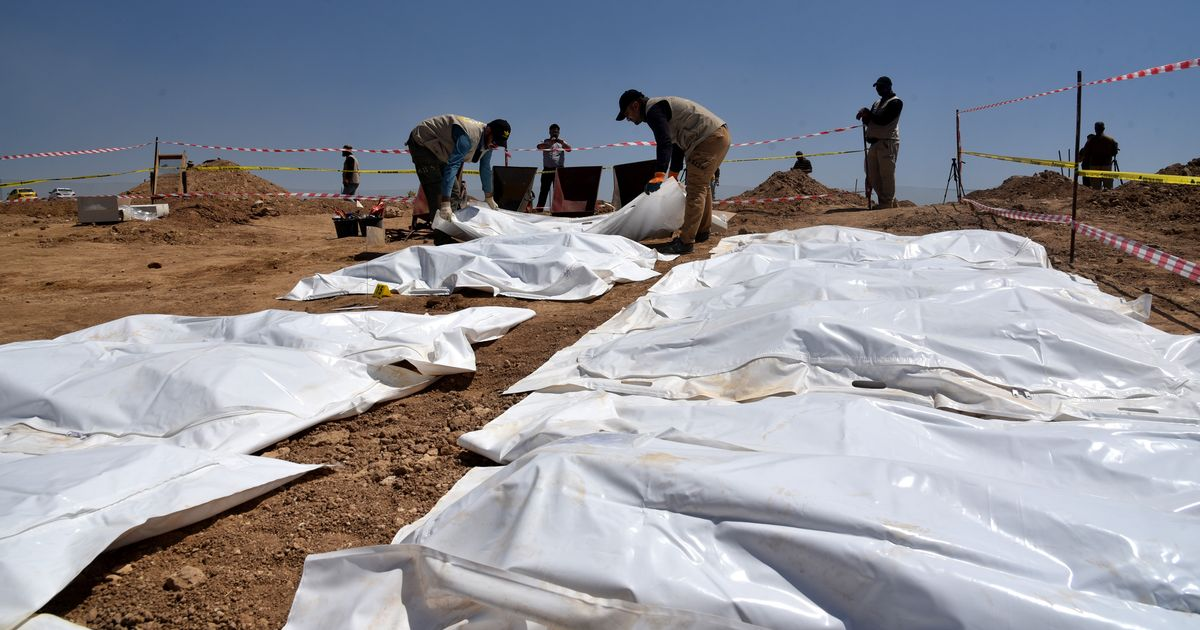 Haunting mass grave of 120 ISIS torture victims unearthed years after brutal massacre