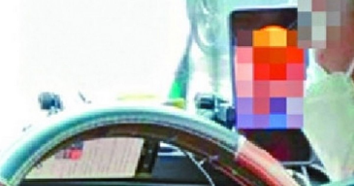 Shocked passengers snap their taxi driver 'watching porn at the wheel' sparking outrage