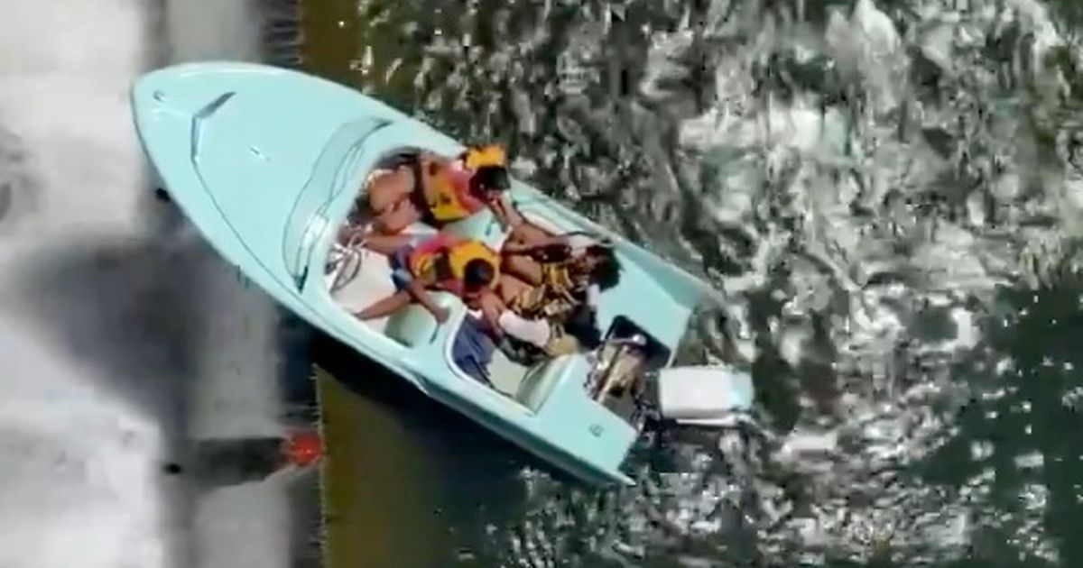 Dizzying moment young women's boat wobbles on edge of killer dam above 36-foot drop