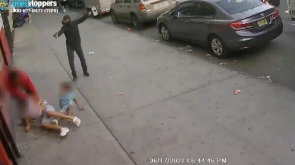 Horror video shows kids inches from death as gunman fires shots at victim