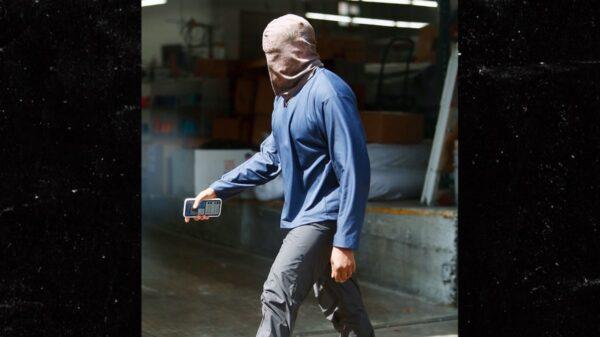 Kanye West Wears Ski-Mask Style Headwear in Heatwave, Irina Shayk Wears Less