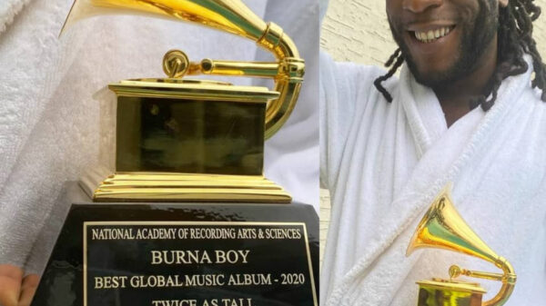 BurnaBoy Shows Off The Grammy Awards Plaque He Just Received (Photos)
