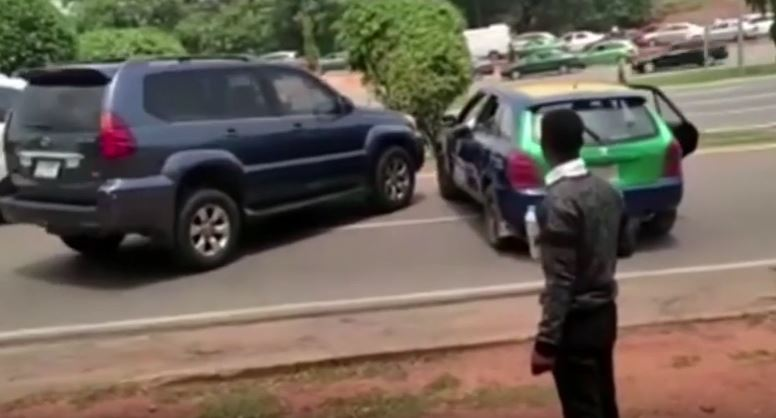Drama As Cab Driver And SUV Driver Clash In The Middle Of A Busy Road In Abuja (Video)