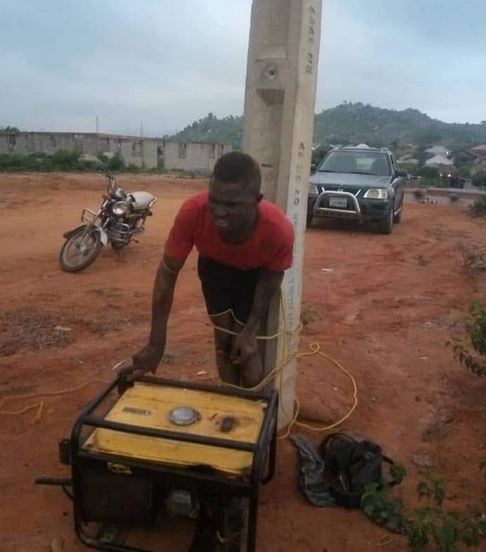 Suspected Thief Nabbed And Tied To Electric Pole For Allegedly Stealing Generator In Abuja (Photos)